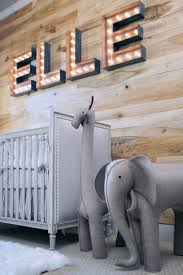 transitional nursery with rustic wood wall 2015 fresh faces of