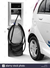 mitsubishi electric car mitsubishi i miev electric car at a charging station stock photo