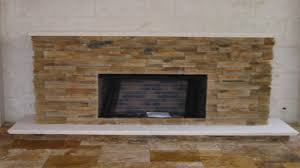 living room stone wall design ideas with vented gas fireplace