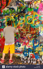 Spray Paint Artist - spray paint artist working at the lennon wall in prauge stock