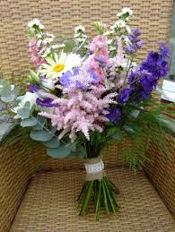 a classic coursage of traditional cottage garden flowers