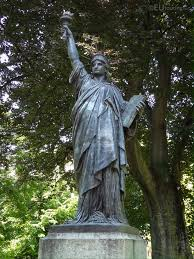 statue with photos of statue of liberty in luxembourg gardens page 301