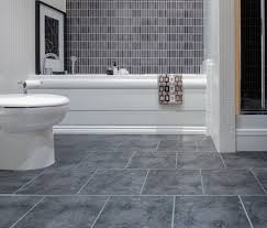 smart modern bathroom interior in fully grey and stone tiles