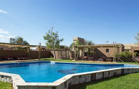 pool area facilities at sossusvlei lodge namibia reception restaurant bar