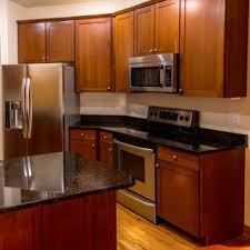 how to sand and stain kitchen cabinets 7 steps to refinishing your kitchen cabinets overstock