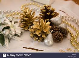 arrangement of christmas decorations of pine cones and beads
