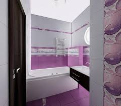 white tub and purple floor tiles with black floating vanity for