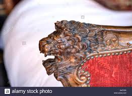 carved lion on a bed post stock photo royalty free image