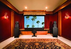 home theater with red wall colors and patterned area rug the