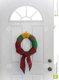country christmas wreath hanging on white door stock photo image