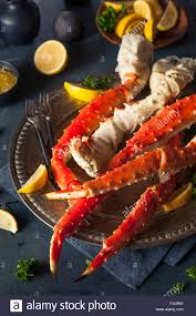 cooked organic alaskan king crab legs with butter stock photo