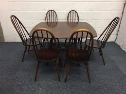 vintage ercol old colonial drop leaf table with six quaker windsor