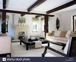 Beige Sofa Living Room by Beige Sofa And Large Black Coffee Table In Modern White Cottage
