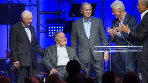 presidents weekend all 5 ex presidents stand on stage calling for unity at hurricane
