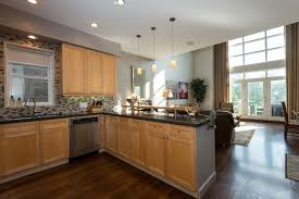 light wood kitchen cabinets with black countertops modern open concept kitchen with light wood cabinets black