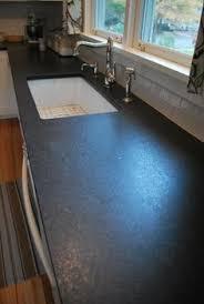 Black Countertop Kitchen - the 25 best coastal inspired granite kitchen counters ideas on