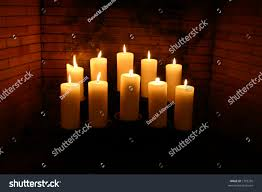 glowing candles fireplace stock photo 1703295 shutterstock glowing candles in a fireplace