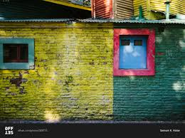 colorful painted brick exterior wall stock photo offset