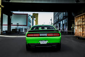 Dodge Challenger Lime Green - grunt gets channeled through either the tremec tr6060 six speed