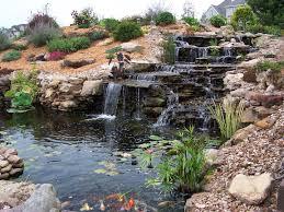 natural backyard pond with decorative rock garden arrangement plus