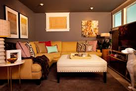 living room art work basement eclectic with upholstered ottoman