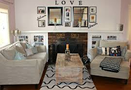 diy livingroom mirror with black wooden frame and pictures on the white wall