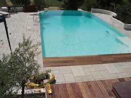 infinity edge pool with deck and glass fences infinity edge