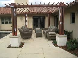 picture of pergolas around patio block backyard kitchen