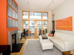 dazzling orange living room ideas with relaxing white bed sofa and