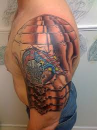 dark armor shoulder tattoos for men photos pictures and