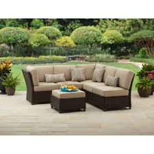 exterior dark wicker furniture with red cushions and lazy boy