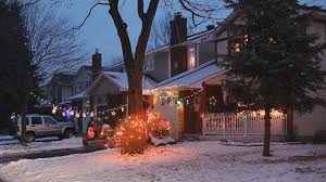 suburban canadian home decorated on the outside with festive