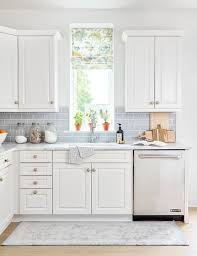 light blue kitchen walls cabinets blue subway tiles with white cabinets and brass knobs