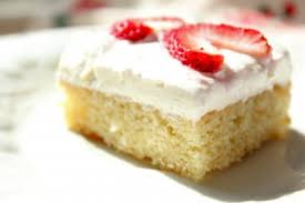 white sheet cake with creamy topping and strawberries tasty