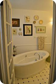 great bathroom with freestanding tub featuring white soaking
