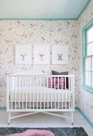 nursery room with double cribs and stars nursery wallpaper