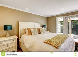 elegant bedroom in american style with white double bed stock