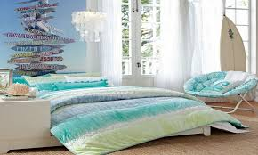 modern beach themed bedroom designs with low profile bed and a