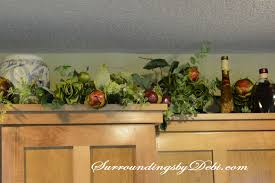 top of kitchen cabinet greenery adding interest to kitchen cabinets