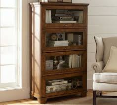 closed bookshelf with glass front lift doors like a library glass