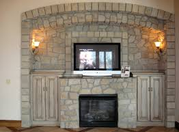 fieldstone fireplace wall arch cabinet added to recessed area