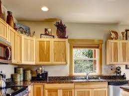top of kitchen cabinet greenery 13 modern ideas for decorating above kitchen cabinets