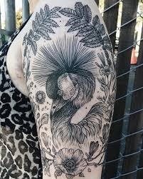 tattoos of flora and fauna reminiscent of woodcut etchings by pony