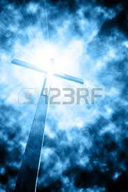 cross in sunrays against cloudy sky stock photo picture and