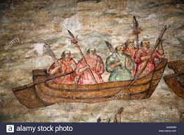 painting of 5 men on a row boat in a storm stock photo royalty