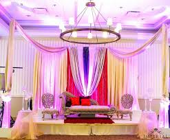 pink purple and white indian wedding stage with deeply colored