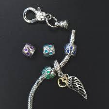 australian shepherd jewelry rainbow paw prints slider memorial bracelet with wing charm