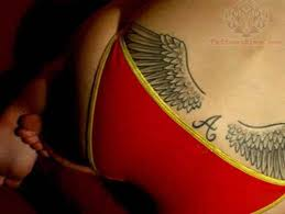 wings tattoos on lowerback