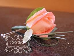 coral boutonniere artificial coral pink and and grass boutonniere side