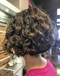 hairstyles for short curly layered hair at the awkward stage this is a short layered naturally and curly bob pinteres